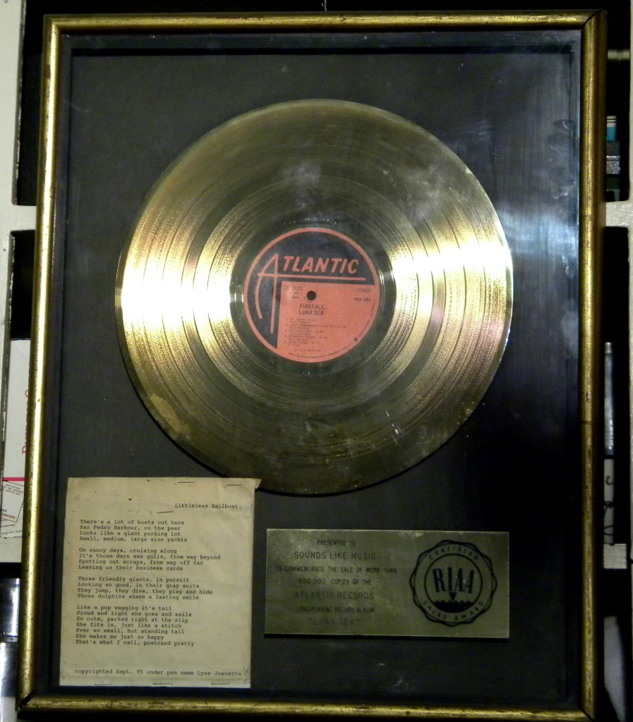 Post Card Pretty in a Framed Gold Record awarded for Luna Sea